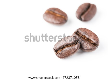 coffee beans isolated on white background,with copy space, soft and selective focus