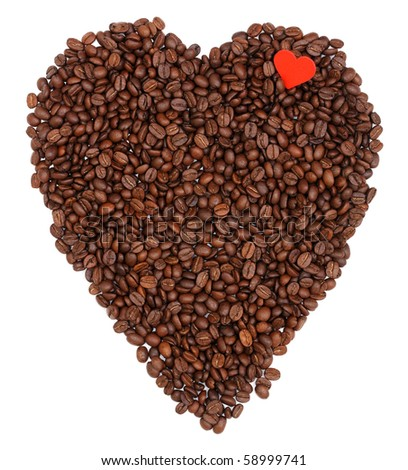 Coffee beans making heart shape with a little red heart on it