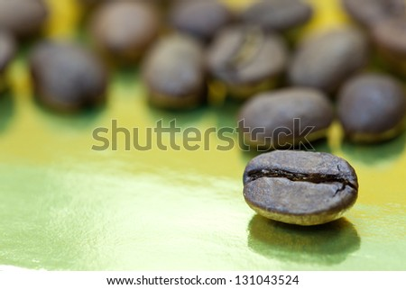 coffee beans on a gold background, close-up