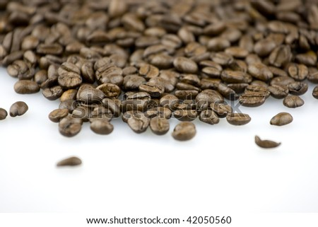 Coffee beans on a white background. - stock photo