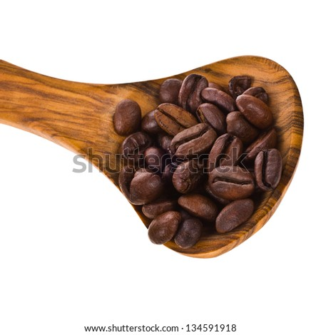 coffee beans on a wooden spoon closeup isolated on white background - stock photo