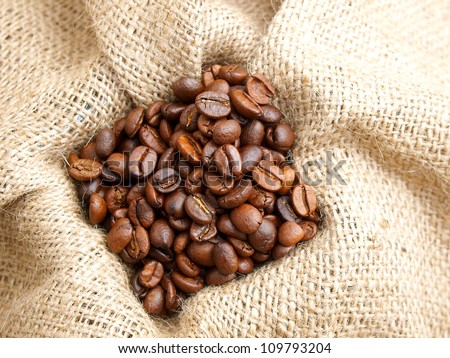 Coffee beans on brown jute background  vintage Bag
