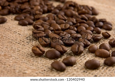 Coffee beans on burlap close up - stock photo