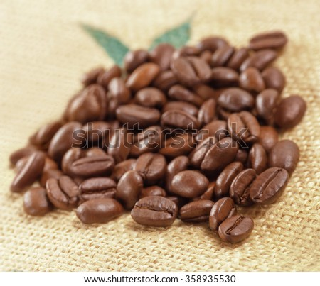 Coffee Beans on Canvas Background. Soft focus. - stock photo