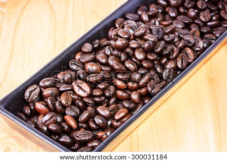 coffee beans on ceramic bowl