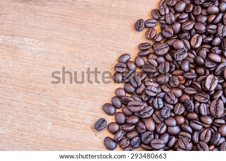 Coffee beans on grunge wooden background for any design