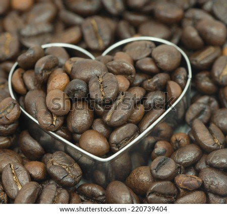 coffee beans on in heart shape box