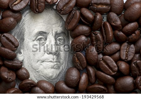 Coffee beans on one hundred dollars - stock photo
