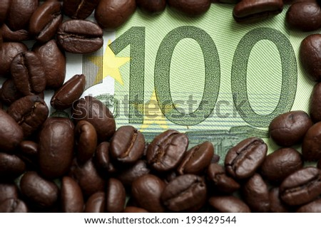 Coffee beans on one hundred euro - stock photo