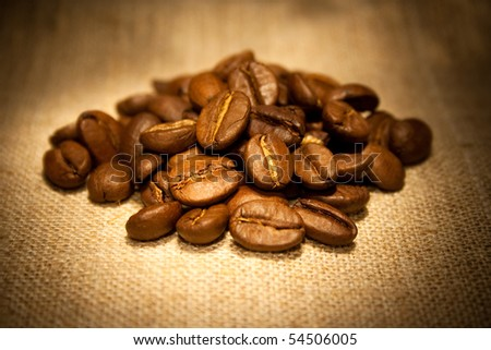 Coffee beans on sacking in warm soft light
