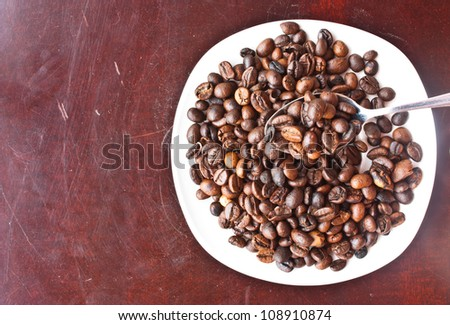 coffee beans on spoon,wood table