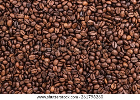 coffee beans on the table background texture - stock photo