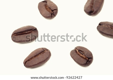 coffee beans on white background, small depth of field