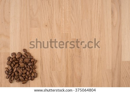 Coffee beans on wood background - stock photo