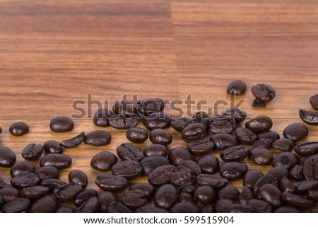 Coffee beans on wood background blank for text