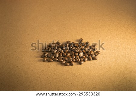 Coffee beans on wood background. culinary coffee still life. - stock photo