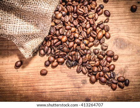 Coffee beans on wooden background, Vintage food photo