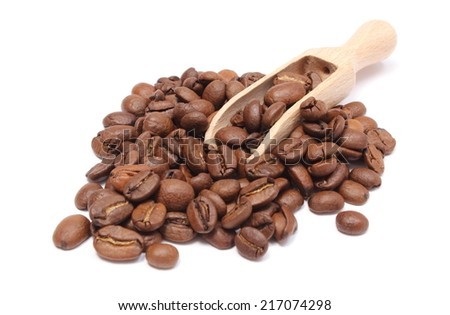 Coffee beans on wooden spoon and heap of coffee, coffee grains. Isolated on white background - stock photo