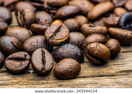Coffee beans over wooden background - stock photo