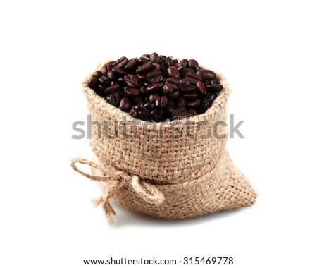Coffee beans roasted in jute sack  isolated on white. - stock photo