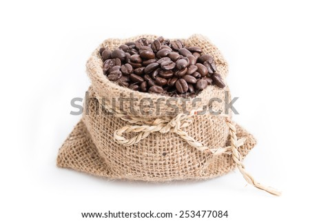 Coffee beans roasted in jute sack. isolated white background. - stock photo