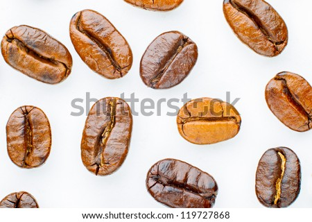 Coffee beans roasted in white background - stock photo
