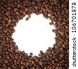 Coffee Beans scattered around a circle - stock photo
