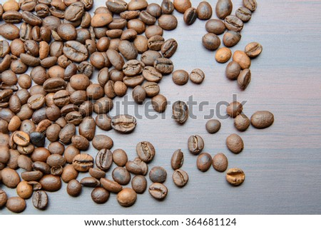 coffee beans scattered on the table