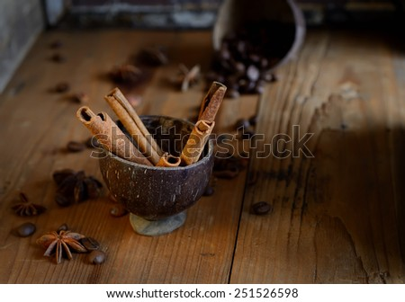 coffee beans, star anise, cinnamon on wooden background - stock photo