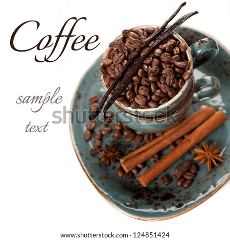 Coffee beans, vanilla, cinnamon and star anise on white background (with sample text) - stock photo