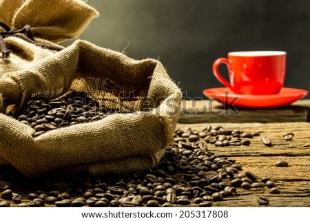 coffee beans with a red cup. - stock photo