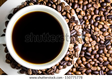 Coffee beans with a white cup - stock photo