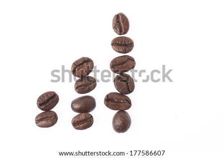 Coffee beans with ceramic spoon on white background.