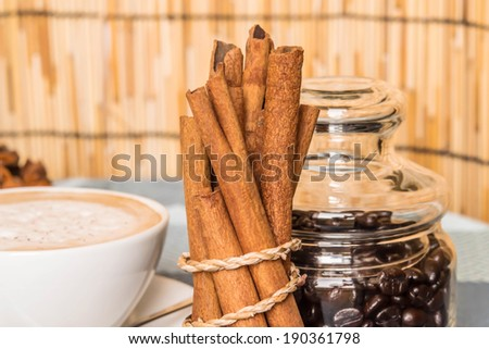 Coffee beans with cinnamon sticks - stock photo