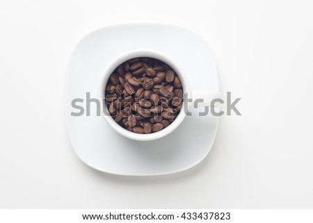 Coffee beans with in coffee cup on white background