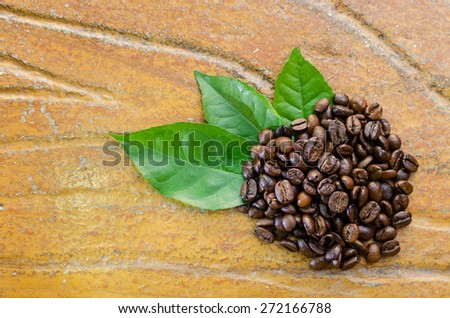 Coffee beans with leaves top view - stock photo