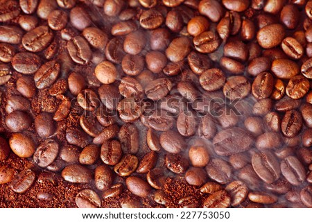 coffee beans with smoke - stock photo