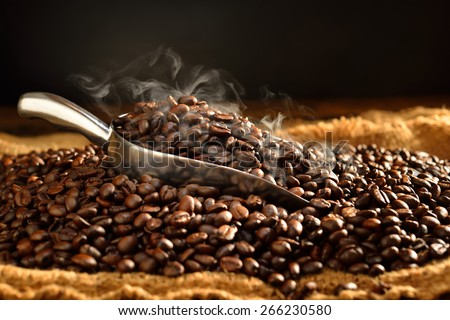 Coffee beans with smoke on burlap,This photo is available without smoke - stock photo