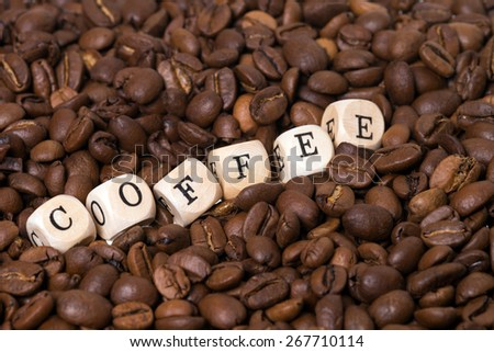 coffee beans with the word Coffee / Fair Trade - stock photo