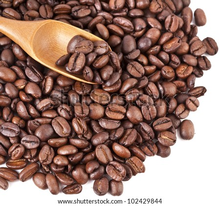 coffee beans with wooden spoon , isolated - stock photo