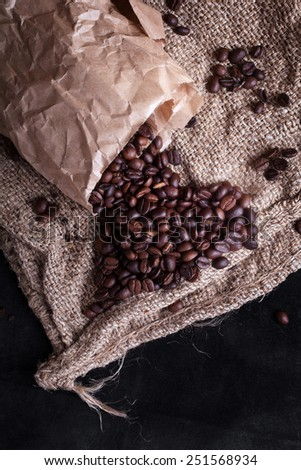 coffee beans woke up from a package in the form of heart - stock photo
