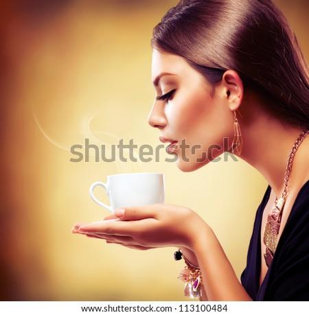 Coffee. Beautiful Girl Drinking Tea or Coffee. Cup of Hot Beverage - stock photo