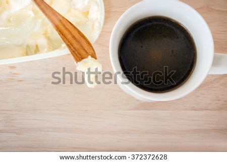 Coffee blended with butter tester good. New trend may forever change the way you drink coffee. Instead of the usual cream and sugar, on wooden background with copy space - stock photo