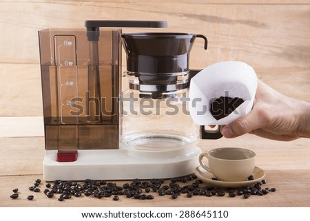 Coffee blender and boiler with coffee seeds - stock photo