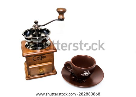 coffee blender with brown ceramic cup on dish