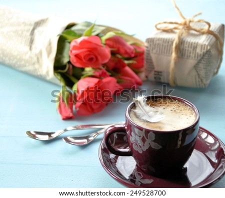 coffee, bouquet of roses and gift