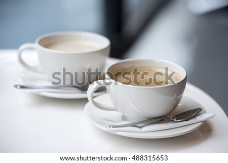 Coffee brake set: two cups of coffee with spoons