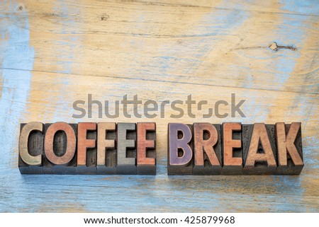 coffee break banner  - text in vintage letterpress wood type blocks stained by color inks against grunge wood with a copy space - stock photo