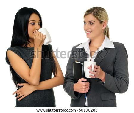 Coffee break for two gorgeous businesswomen - stock photo