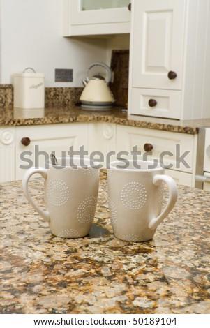 Coffee break in a modern kitchen interior - stock photo